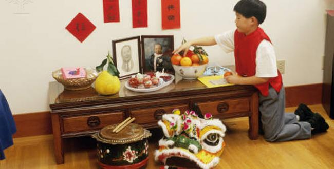 a_chinese-american_boy_tends_the_family_altar_san_francisco_california.jpg